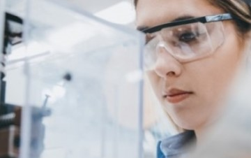 Closeup of woman in lab gear