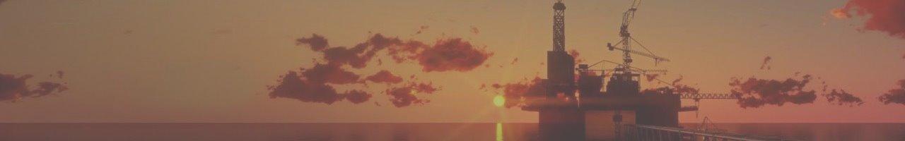 Oil Rig against red-orange evening sky