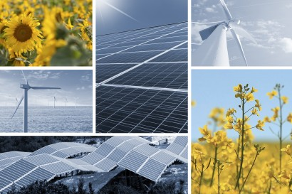 Ecologic energy collage with solar cell, windmill, sunflowers, and rapeseed flowers